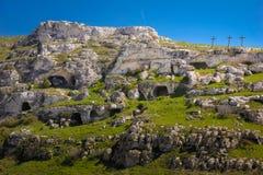 Rupestrian Churches Park. Matera. Basilicata. Apulia. Italy. Paleolithic caves excavated and three crosses. Matera. Basilicata. Apulia or Puglia . Italy royalty free stock images