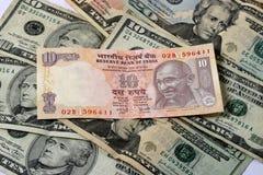 Rupia contra o dólar Fotografia de Stock Royalty Free