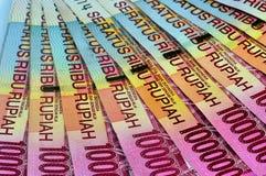Rupia de la pila Rp.100.000 del dinero. Imágenes de archivo libres de regalías