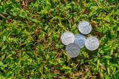 Rupiah coin money on green grass. Multiple five hundred Indonesia Rupiah coin money on green grass Stock Photo