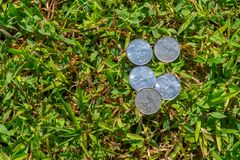 Rupiah coin money on green grass. Multiple two hundred Indonesia Rupiah coin money on green grass Stock Photography