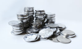 Rupiah coins on white background. With shadow Stock Photography