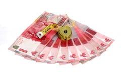 Rupiah - indonesiska pengar Fotografering för Bildbyråer