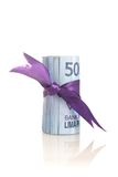 Rupiah - indonesiska pengar med lilabandet Royaltyfri Fotografi