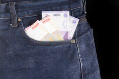 Rupiah money at jeans, at black background Royalty Free Stock Photos