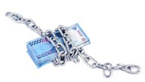 Rupiahpengar och kedjar Arkivfoto