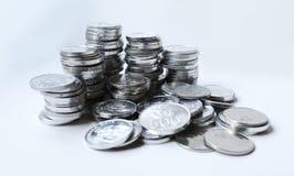 Rupiemünzen auf weißem Hintergrund Stockfotografie