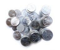 Rupiemünzen auf weißem Hintergrund Lizenzfreies Stockfoto