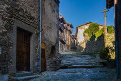 RUPIT, CATALONIA, SPAIN April 2016: A view of the medieval street on volcanic rock Stock Images
