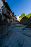 RUPIT, CATALONIA, SPAIN April 2016: A view of the medieval street on volcanic rock Royalty Free Stock Images