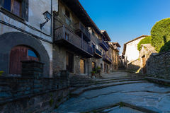 RUPIT, CATALONIA, SPAIN April 2016: A view of the medieval street on volcanic rock Stock Photos