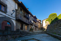 RUPIT, CATALONIA, SPAIN April 2016: A view of the medieval street on volcanic rock Royalty Free Stock Image