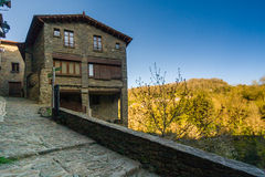 RUPIT, CATALONIA, SPAIN April 2016: view of the medieval town of Rupit-  street with brutal rustic medieval house Stock Photography