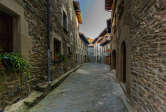 RUPIT, CATALONIA, SPAIN April 2016: A view of the medieval town of Rupit street with brutal rustic medieval houses Royalty Free Stock Photos