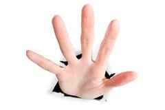 Ruptura da mão através do papel Imagem de Stock Royalty Free