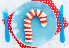Ruptura engraçada e saudável do bastão de doces da morango da banana - do Natal fotos de stock royalty free