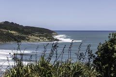 Rupturas do ponto do Raglan, NZ foto de stock