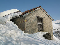 Rural alpine hut in winter. Snow on rural alpine hut in winter - Italian Alps Royalty Free Stock Photo