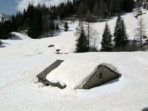 Rural alpine hut in winter. Snow on rural alpine hut in winter - Italian Alps Stock Photography