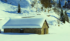 Rural alpine hut in winter Stock Photo