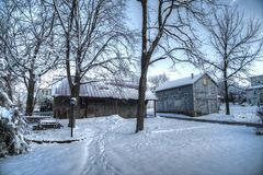 Rural America snow scene with old barns Stock Images