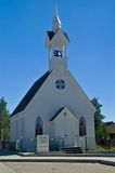 Rural American Country Church. A rural American country church sits idle on a Sunday Morning before service begins royalty free stock image