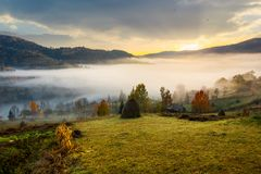 Rural area on foggy autumn morning. Gorgeous countryside landscape in mountains Stock Photography