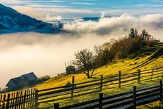 Rural area on hillside in rising cloud at sunrise Royalty Free Stock Photos