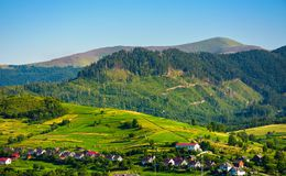 Rural area in mountains at sunset. Lovely summer landscape of Volovets town, Ukraine. mountain Velykyi Verkh is seen in the far distance Stock Photo