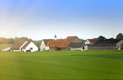 Rural areas in Germany, Bavaria, with brightly green fields and trees small and village Stock Photos