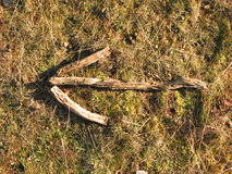 Rural arrow left. An arrow made of sticks on the ground points left.. or flipped.. to the right stock images