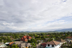 Rural asian city view. House in rural asian city near mountain Stock Photography