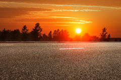 The rural asphalt road in the sunset Stock Image