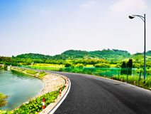 A rural asphalt road. Very clean highway through the lakes and mountains Royalty Free Stock Image