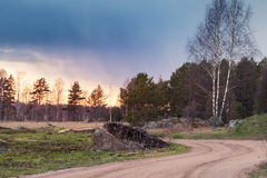 Rural autumn landscape with empty road. At evening Royalty Free Stock Photo