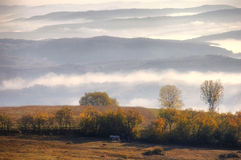 Rural autumn landscape with fog Stock Photos
