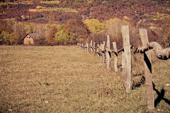 Rural autumn landscape in the mountains . The fence passing into distance tiny house Stock Photography