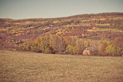 Rural autumn landscape in the mountains . The fence passing into distance tiny house Stock Photo