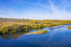 Rural autumn landscape with river. Legostaeva village on the Bank of the Berd river, Novosibirsk oblast, Siberia, Russia - September 11, 2016: rural autumn Royalty Free Stock Photos