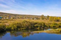 Rural autumn landscape with river. Legostaeva village on the Bank of the Berd river, Novosibirsk oblast, Siberia, Russia - September 11, 2016: rural autumn Stock Image