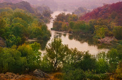 Rural autumn sunset. Landscape with river and  colorful trees Stock Photography