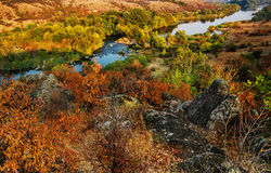 Rural autumn sunset. Landscape with river and  colorful trees Stock Photos