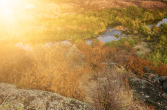 Rural autumn sunset. Sunny soft landscape with river and  colorful trees, seasonal background Royalty Free Stock Photos