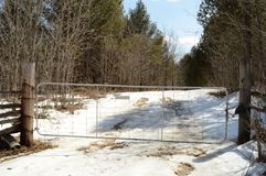 Rural Backroad Gate. Rural gate closed for private access to a backroad to cottage life stock photos