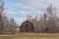 Rural barn. Brown barn with a wooden fence Royalty Free Stock Images