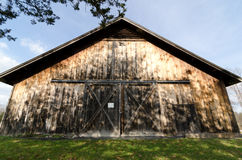 Rural Barn Front. Exterior entrance of old worn barn stock photography