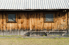 Rural Barn Wall. Exterior wall of old worn barn with bench stock photo