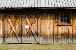 Rural Barn Wall. Exterior wall of old worn barn doors royalty free stock photo
