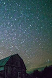 Rural barns at night with stars in winter Stock Photo