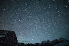 Rural barns at night with stars in winter Royalty Free Stock Image